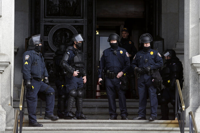 Capitol Police stand at the main entrance of the Pennsylvania State Capitol Sunday Jan. 17, 2021 in Harrisburg, Pa. (AP Photo/Jacqueline Larma)