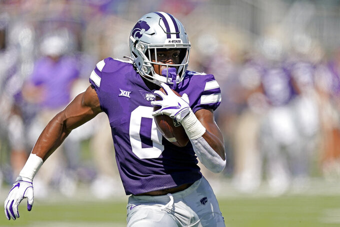 Kansas State tight end Daniel Imatorbhebhe runs the ball for a touchdown during the first half of an NCAA college football game against Nevada Saturday, Sept. 18, 2021, in Manhattan, Kan. (AP Photo/Charlie Riedel)