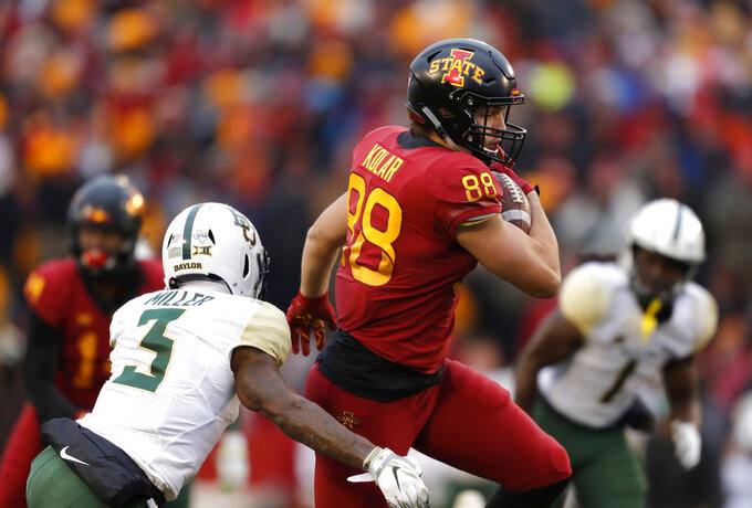 Iowa State tight end Charlie Kolar, right, tries to elude a tackle by Baylor safety Chris Miller, left, during the first half of an NCAA college football game, Saturday, Nov. 10, 2018, in Ames. (AP Photo/Matthew Putney)