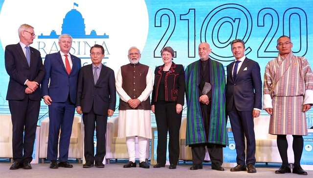 In this photo released by Indian government Press Information Bureau, Indian Prime Minister Narendra Modi, fourth left, poses with other leaders during the inaugural session of  Raisina Dialogue, a global conference to discuss the most challenging issues facing the world community in New Delhi, India, Tuesday, Jan.14, 2020. (Indian government Press Information Bureau via AP)