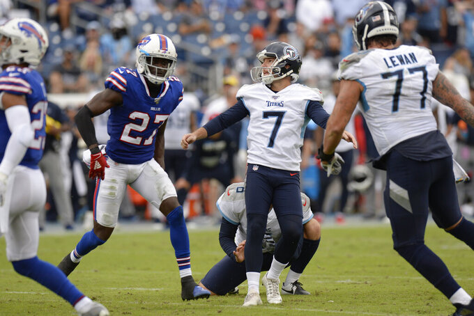 Tennessee Titans kicker Cairo Santos (7) watches his kick as he misses his second straight field goal attempt against the Buffalo Bills in the first half of an NFL football game Sunday, Oct. 6, 2019, in Nashville, Tenn. (AP Photo/Mark Zaleski)