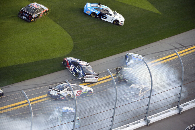 William Byron (24), Martin Truex Jr. (19) and Kurt Busch (1) are involved in a multi-car accident along the front stretch after a restart from an earlier accident during the NASCAR Daytona Clash auto race at Daytona International Speedway, Sunday, Feb. 9, 2020, in Daytona Beach, Fla. (AP Photo/Phelan M. Ebenhack)