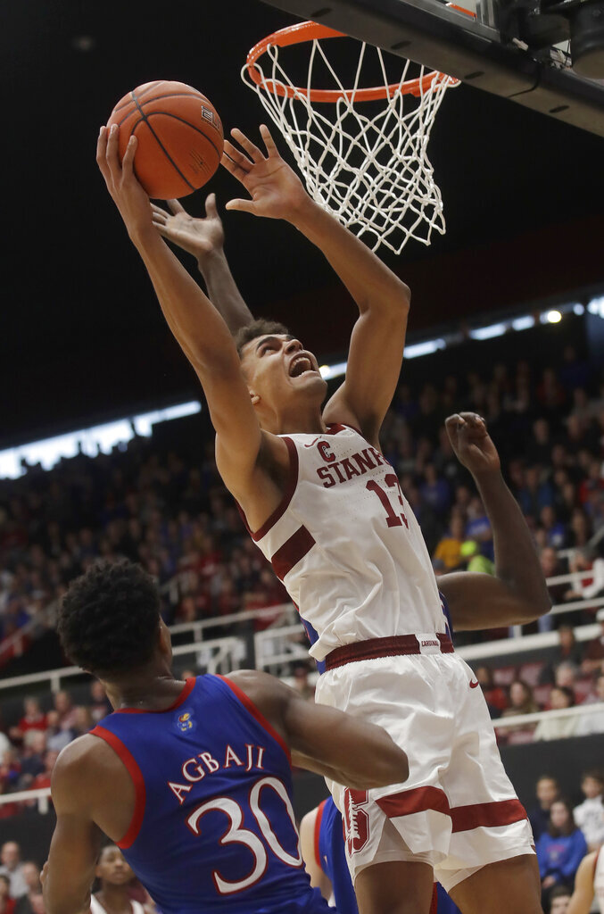 Stanford forward Oscar da Silva (13) shoots over Kansas guard Ochai Agbaji (30) during the first half of an NCAA college basketball game in Stanford, Calif., Sunday, Dec. 29, 2019. (AP Photo/Jeff Chiu)
