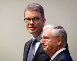 CEO of Deutsche Bank Christian Sewing, left, and head of supervisory board Paul Achleitner are on their way to the annual shareholders meeting in Frankfurt, Germany, Thursday, May 23, 2019. (AP Photo/Michael Probst)