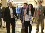 FILE - In this March 26, 2018, file photo, Buffalo Bills owners Terry, left, and Kim Pegula, front, leave a conference room during the NFL owners meetings in Orlando, Fla. Kim Pegula tells The Associated Press the clock on deciding whether to build a new stadium or renovate the team's current facility won't begin ticking until after New York's gubernatorial race is settled in November. Pegula describes that timetable as being