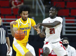 Pittsburgh's Justin Champagnie (11) and N.C. State's Ebenezer Dowuona (21) go after the ball during the first half of an NCAA college basketball game in Raleigh, N.C., Sunday, Feb. 28, 2021. (Ethan Hyman/The News & Observer via AP)