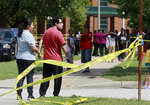 People gather outside of Heritage High School following a shooting, Monday, Sept. 20, 2021, in Newport News, Va. (Kaitlin McKeown/The Virginian-Pilot via AP)