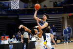 Marquette's Dawson Garcia, top, goes up for a shot against Villanova's Jermaine Samuels during the second half of an NCAA college basketball game, Wednesday, Feb. 10, 2021, in Villanova, Pa. (AP Photo/Matt Slocum)