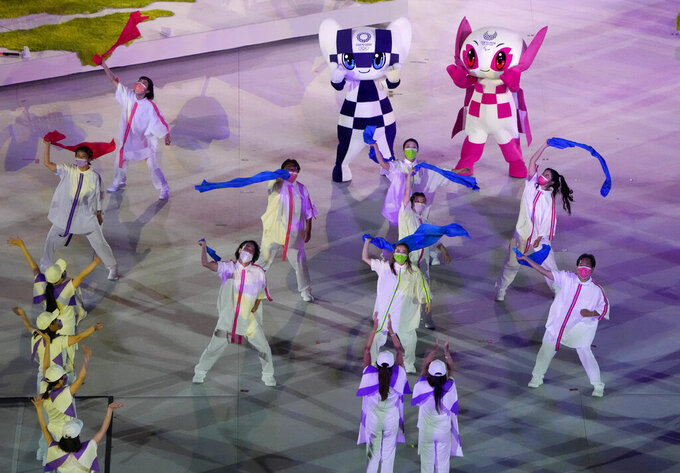 Dancers perform during the closing ceremony for the 2020 Paralympics at the National Stadium in Tokyo, Sunday, Sept. 5, 2021. (AP Photo/Eugene Hoshiko)
