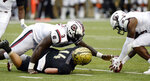 FILE - In this Sept. 22, 2018, file photo, South Carolina defensive lineman Aaron Sterling, right, recovers a fumble by Vanderbilt quarterback Kyle Shurmur (14) after being hit by Javon Kinlaw (3) during the second half of an NCAA college football game, in Nashville, Tenn. Kinlaw was selected to The Associated Press All-America team, Monday, Dec. 16, 2019. (AP Photo/Mark Zaleski, File)