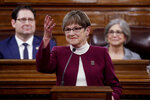 Flanked by Speaker of the House Ron Ryckman, left, and Senate President Susan Wagle, Gov. Laura Kelly delivers her State of the State address Wednesday, Jan. 15, 2020, in Topeka, Kan. (AP Photo/Charlie Riedel)