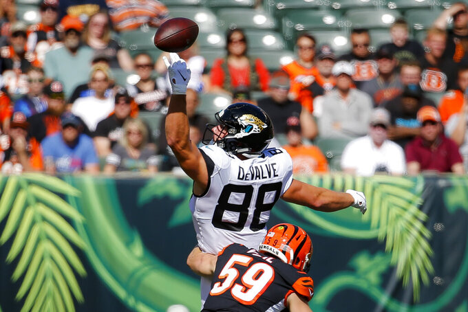Jacksonville Jaguars tight end Seth DeValve (88) misses a pass against Cincinnati Bengals outside linebacker Nick Vigil (59) in the first half of an NFL football game, Sunday, Oct. 20, 2019, in Cincinnati. (AP Photo/Frank Victores)
