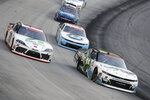 Harrison Burton (20) goes high around Justin Haley (11) during NASCAR Xfinity Series auto race at Bristol Motor Speedway Monday, June 1, 2020, in Bristol, Tenn. (AP Photo/Mark Humphrey)
