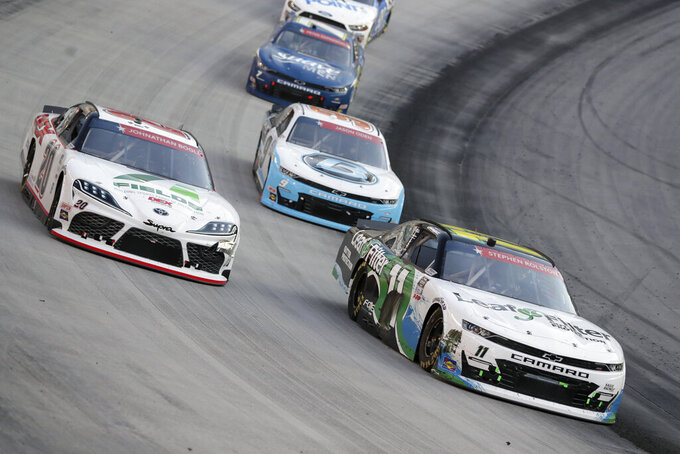 Harrison Burton (20) goes high around Justin Haley (11) during NASCAR Xfinity Series auto race at Bristol Motor Speedway Monday, June 1, 2020, in Bristol, Tenn. (AP Photo/Mark Humphrey)