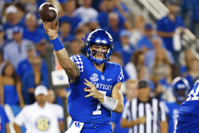 Kentucky quarterback Will Levis (7) throws a pass during the second half of an NCAA college football game against Florida in Lexington, Ky., Saturday, Oct. 2, 2021. (AP Photo/Michael Clubb)