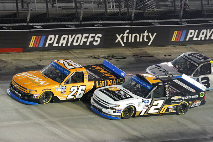 Tyler Ankrum (26) and Sheldon Creed (2) drive into Turn Four during a NASCAR Truck Series auto race Thursday Sept. 17, 2020, in Bristol, Tenn. (AP Photo/Steve Helber)