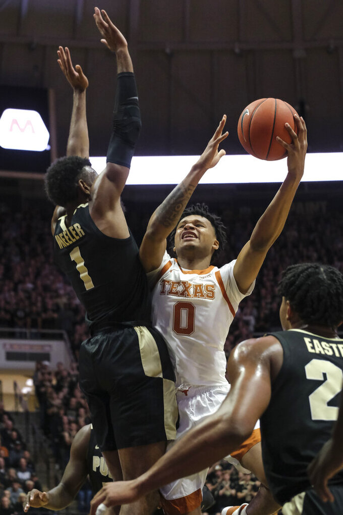 Texas forward Gerald Liddell (0) shoots over Purdue forward Aaron Wheeler (1) in the first half of an NCAA college basketball game in West Lafayette, Ind., Saturday, Nov. 9, 2019. (AP Photo/AJ Mast)