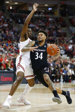 Cincinnati's Jarron Cumberland, right, drives to the basket against Ohio State's Andre Wesson during the first half of an NCAA college basketball game Wednesday, Nov. 6, 2019, in Columbus, Ohio. (AP Photo/Jay LaPrete)