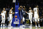 Georgetown's Qudus Wahab (34) reacts after making a basket during the first half of an NCAA college basketball game against Villanova, Saturday, Jan. 11, 2020, in Philadelphia. (AP Photo/Matt Slocum)