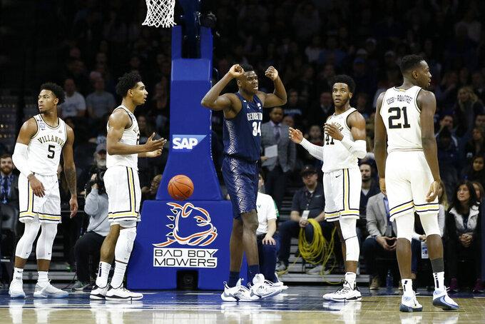 Georgetown's Qudus Wahab (34) reacts after making a basket during the first half of an NCAA college basketball game against Villanova, Saturday, Jan. 11, 2020, in Philadelphia. (AP Photo/Matt Slocum)