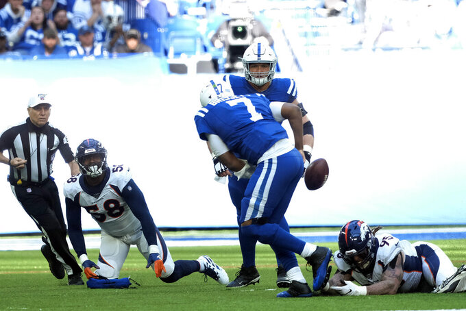 Indianapolis Colts quarterback Jacoby Brissett (7) fumbles during the second half of an NFL football game against the Denver Broncos, Sunday, Oct. 27, 2019, in Indianapolis. The fumble was recovered by the Broncos. (AP Photo/AJ Mast)