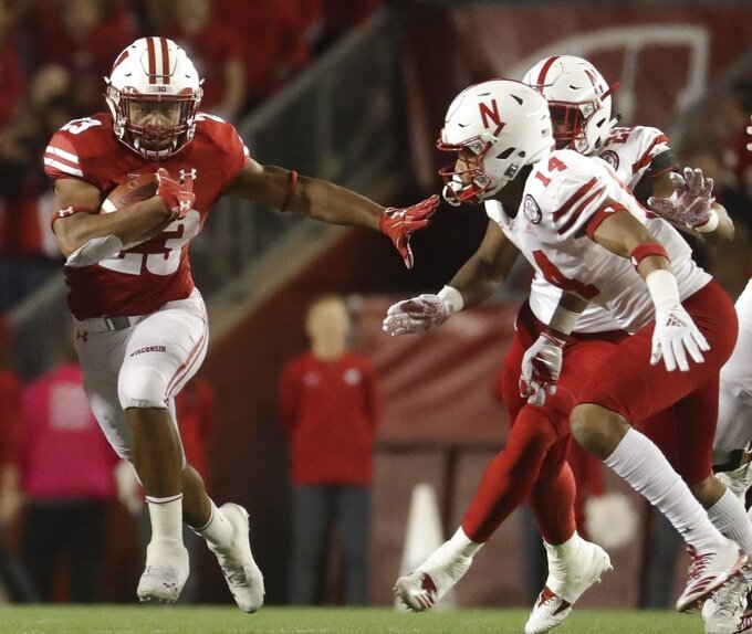 FILE - In this Saturday, Oct. 6, 2018, file photo, Wisconsin's Jonathan Taylor runs during the second half of an NCAA college football game against Nebraska in Madison, Wis. No. 12 Michigan is undefeated since opening with a loss at Notre Dame, building momentum and confidence while waiting for its next opportunity to earn an impressive win. They won't have to wait much longer. No. 15 Wisconsin will come to play under the lights Saturday night at the Big House in what may prove to be a pivotal game in the conference's championship race. (AP Photo/Morry Gash, File)