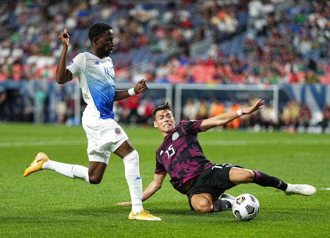 Costa Rica's Keysher Fuller (4) and Mexico's Héctor Moreno (15) go after the ball during the first half of a CONCACAF Nations League soccer semifinal Thursday, June 3, 2021, in Denver. (AP Photo/Jack Dempsey)