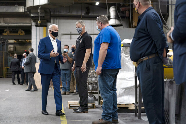Democratic presidential candidate former Vice President Joe Biden tours the Wisconsin Aluminum Foundry in Manitowoc, Wis., Monday, Sept. 21, 2020. (AP Photo/Carolyn Kaster)