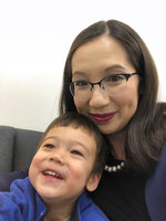 "CORRECTS TO GEORGE WASHINGTON UNIVERSITY, NOT GEORGETOWN - This March 11, 2020 photo provided by Dr. Leana Wen shows her with her son in Baltimore. Wen, a George Washington University public health specialist, who is pregnant and due to give birth soon, says she wants answers as a physician and as a patient to her concerns over the coronavirus. ""There is very limited information available,"" she said. Her greatest fear is developing a COVID-19 infection or symptoms that would force her to be separated from her newborn for days or weeks. (Dr. Leana Wen via AP)"