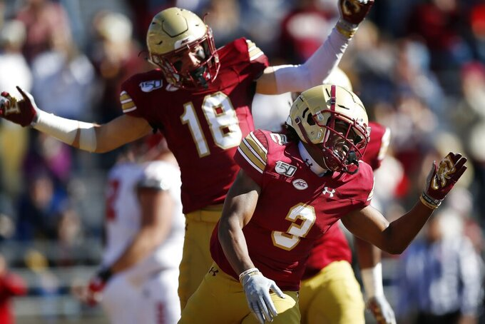Boston College defensive back Jason Maitre (3) celebrates his interception and touchdown during the first half of an NCAA college football game against North Carolina State in Boston, Saturday, Oct. 19, 2019. (AP Photo/Michael Dwyer)