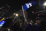 Baseball fans celebrate downtown after the Los Angeles Dodgers won the World Series over the Tampa Bay Rays Tuesday, Oct. 27, 2020, in Los Angeles. (AP Photo/Ashley Landis)