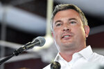 FILE - In this Aug. 3, 2019, file photo, Kentucky republican candidate for Agriculture Commissioner, Ryan Quarles, addresses the audience gathered at the Fancy Farm Picnic in Fancy Farm, Ky. Quarles was re-elected as Kentucky commissioner of agriculture Tuesday, Nov. 5. (AP Photo/Timothy D. Easley, File)