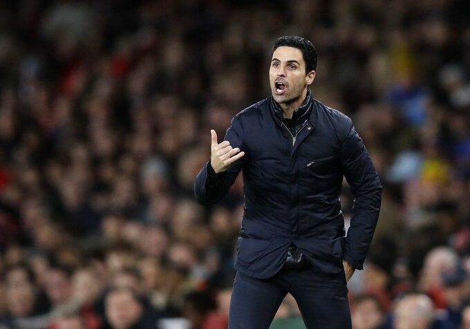 FILE - In this Sunday, Feb. 23, 2020 file photo Arsenal's head coach Mikel Arteta shouts out from the touchline during the English Premier League soccer match between Arsenal and Everton at Emirates stadium in London. Arsenal manager Mikel Arteta has tested positive for the coronavirus, forcing the club to close its training complex and put the entire first-team in self isolation. For most people, the new COVID-19 coronavirus can cause only mild or moderate symptoms, but for some it can cause more severe illness. (AP Photo/Kirsty Wigglesworth, File)