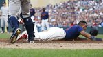Minnesota Twins' Luis Arraez loses his helmet as he slides by New York Yankees catcher Austin Romine to score on a sacrifice fly by Jake Cave in the second inning of a baseball game Wednesday, July 24, 2019, in Minneapolis. (AP Photo/Jim Mone) 55