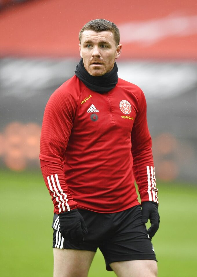 Sheffield United's John Fleck warms up before the English Premier League soccer match between Sheffield United and Crystal Palace at Bramall Lane in Sheffield, England, Saturday, May 8, 2021. (AP Photo/Peter Powell, Pool)