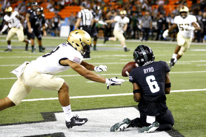 While being guarded by Army defensive back Javhari Bourdeau (8), Hawaii wide receiver Cedric Byrd II (6) can't hold on to a pass in the end zone during the first half of an NCAA college football game Saturday, Nov. 30, 2019 in Honolulu. (AP Photo/Marco Garcia)