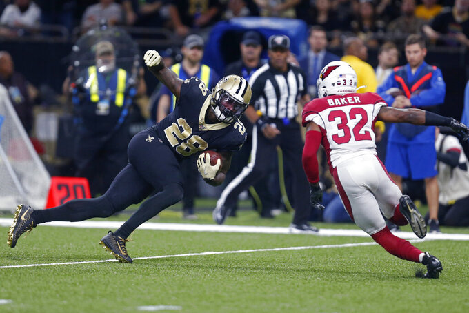 New Orleans Saints running back Latavius Murray (28) carries against Arizona Cardinals strong safety Budda Baker (32) in the first half of an NFL football game in New Orleans, Sunday, Oct. 27, 2019. (AP Photo/Butch Dill)