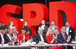 Party secretary Lars Klingbeil, Norbert Walter-Borjans, Saskia Esken, Federal Finance Minister Olaf Scholz, Manuela Schwesig and Thorsten Schaefer-Guembel, from left, during the  German Social Democrats, SPD, federal party conference in Berlin, Germany, Friday, Dec. 6, 2019. Members of the center-left party have choosen the left-leaning duo Norbert Walter-Borjans and Saskia Esken as their new leaders. This has to be confirmed by the delegates at the party meeting. (Kay Nietfeld/dpa via AP)