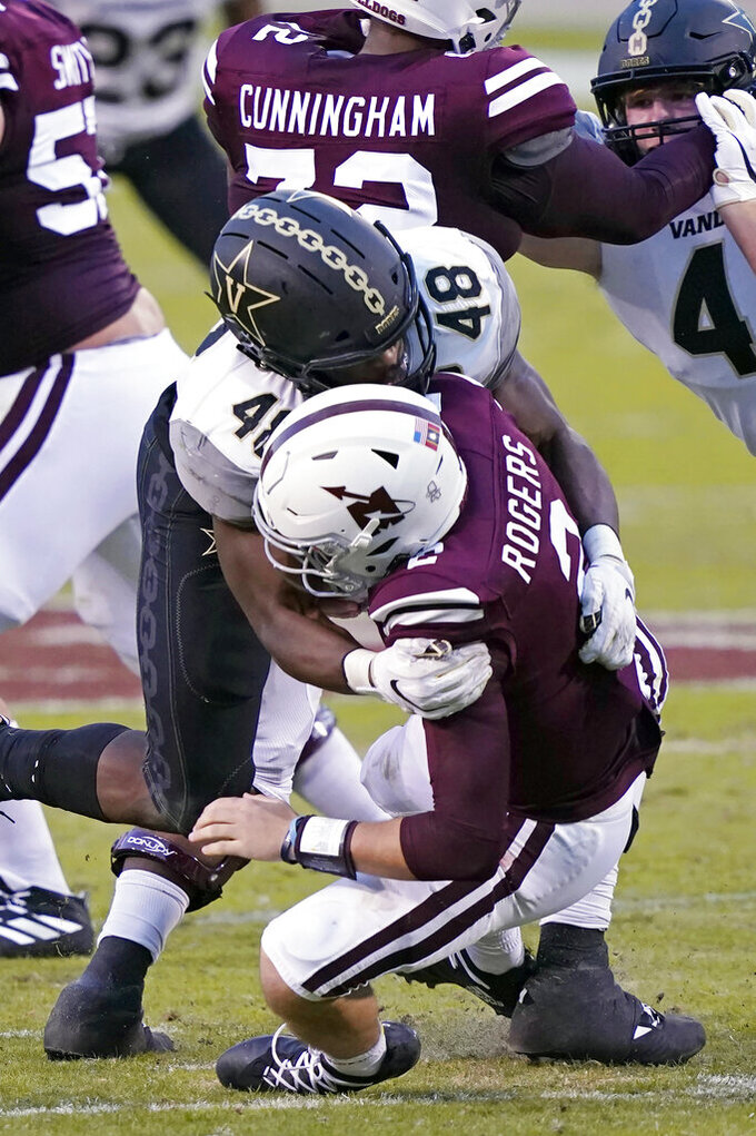 Mississippi State quarterback Will Rogers (2) is sacked by Vanderbilt linebacker Andre Mintze (48) during the second half of an NCAA college football game in Starkville, Miss., Saturday, Nov. 7, 2020. (AP Photo/Rogelio V. Solis)