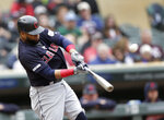 Cleveland Indians Carlos Santana hits a home run against the Minnesota Twins in the third inning during a baseball game Sunday, Sept. 8, 2019 in Minneapolis. (AP Photo/Andy Clayton-King)