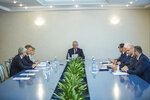 Moldova's President Igor Dodon, center, presides over the country's Supreme Security Council in Chisinau, Moldova, Tuesday, June 11, 2019. Dodon, who is temporarily suspended from his duties by Moldova's constitutional court who appointed an interim president, called the decision anti-constitutional. (AP Photo/Roveliu Buga)