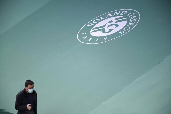 A man walk in the stadium during the first round match at the Roland Garros stadium Sunday, May 30, 2021 in Paris. (AP Photo/Christophe Ena)