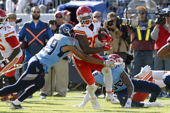Kansas City Chiefs running back Damien Williams (26) is hit by Tennessee Titans inside linebacker Wesley Woodyard (59) in the first half of an NFL football game Sunday, Nov. 10, 2019, in Nashville, Tenn. (AP Photo/Mark Zaleski)