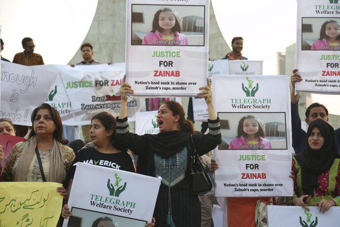 Activists of Pakistan civil society protest to condemn the rape and killing of Zainab Ansari, an 8-year-old girl, in Karachi, Pakistan, Friday, Jan. 12, 2018. Anees Ansari, Zainab's father accused the police of being slow to respond when his daughter went missing in the eastern Punjab province. Two people were killed and three others were wounded in clashes between angry Kasur residents and police after protesters enraged over her death attacked a police station in the city. (AP Photo/Shakil Adil)