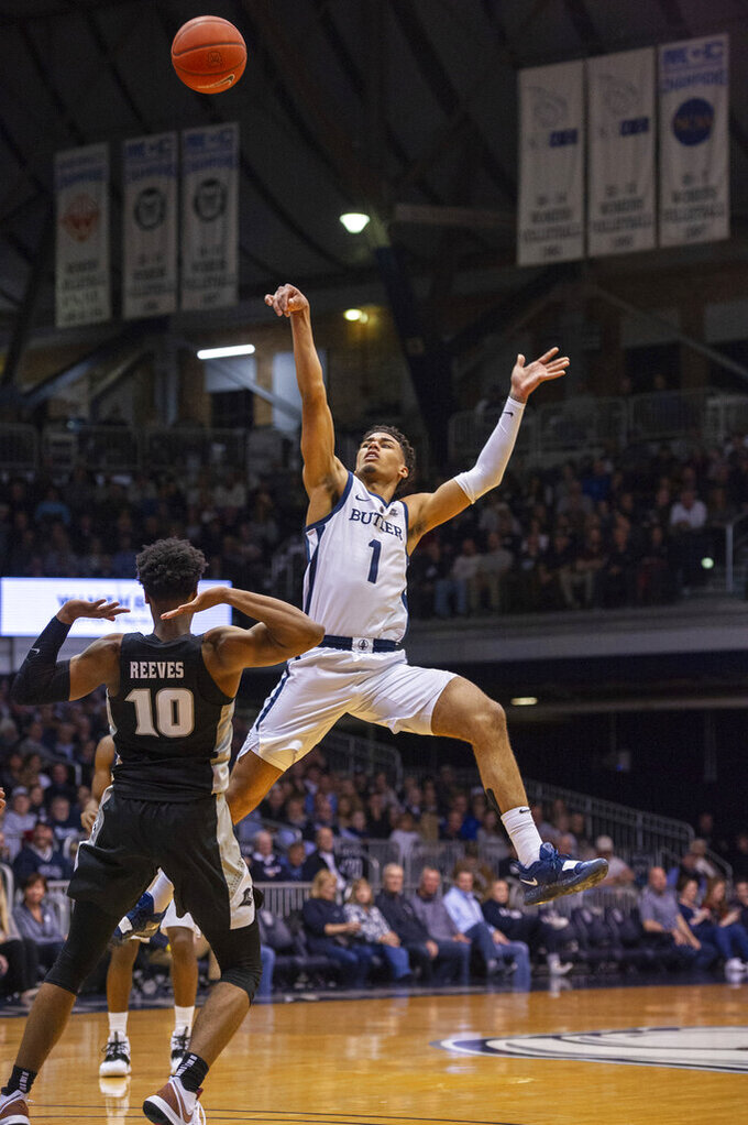Butler forward Jordan Tucker (1) puts up an off-balanced shot during the first half of an NCAA college basketball game against Providence, Tuesday, Feb. 26, 2019, in Indianapolis. (AP Photo/Doug McSchooler)