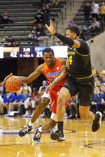 Florida's Scottie Lewis, left, tries to dribble past Missouri's Javon Pickett, right, during the first half of an NCAA college basketball game Saturday, Jan. 11, 2020, in Columbia, Mo. (AP Photo/L.G. Patterson)