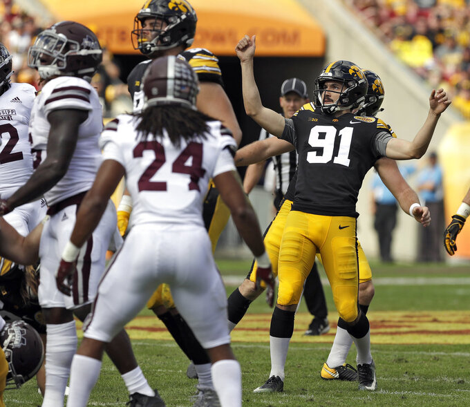Iowa place kicker Miguel Recinos (91) celebrates after his field goal against Mississippi State during the first half of the Outback Bowl NCAA college football game Tuesday, Jan. 1, 2019, in Tampa, Fla. (AP Photo/Chris O'Meara)