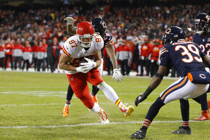 Kansas City Chiefs tight end Travis Kelce (87) scores on a 6-yard touchdown reception in the first half of an NFL football game against the Chicago Bears in Chicago, Sunday, Dec. 22, 2019. (AP Photo/Charles Rex Arbogast)
