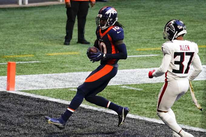 Denver Broncos wide receiver Jerry Jeudy (10) runs into the end zone for a touchdown against Atlanta Falcons free safety Ricardo Allen (37) during the second half of an NFL football game, Sunday, Nov. 8, 2020, in Atlanta. (AP Photo/Brynn Anderson)