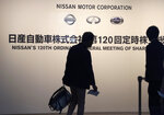 Shareholders arrive at a conference hall to attend Nissan's general meeting of shareholders in Yokohama, near Tokyo, Tuesday, June 25, 2019. Japanese automaker Nissan faces shareholders as profits and sales tumble after its former star chairman faces trial on financial misconduct allegations.(AP Photo/Koji Sasahara)